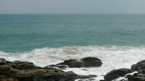 big waves crashing on stone beach Footage