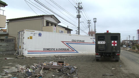 Tsunami Destruction And Aftermath In Japan Washed Up Shipping Container stock footage