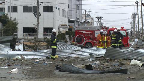 Japan Tsunami Aftermath - Fire Crew Walks Through Port Footage