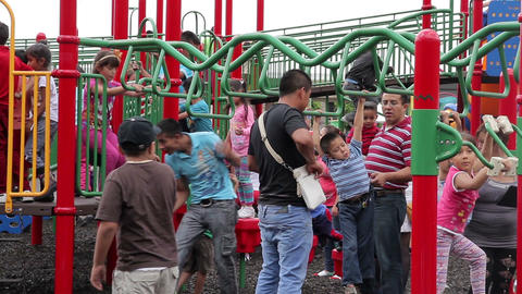Mexico City, Mexico-August 2014: FULL SHOT. Children Having Fun In Climbers And  stock footage