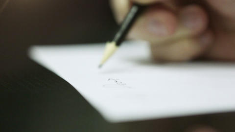 Hand Writing on a Piece of Paper. DOF. HD 1080 Footage