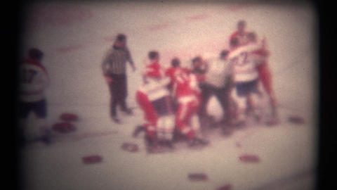 (8mm Vintage 1970s) Hockey Fight From Above. A bunch of hockey players fighting Footage