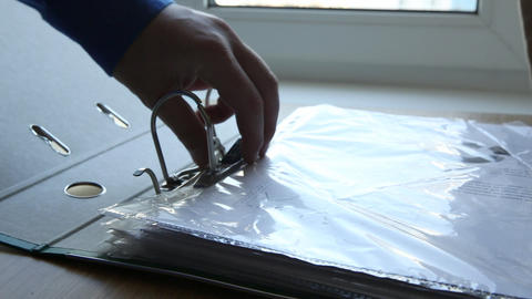 Taking A Document From A Holder stock footage