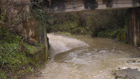Creek Along Road Under Bridge 4 stock footage