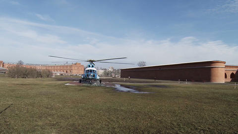 Helicopter stands on takeoff site Footage