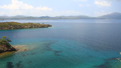 High angle panoramic shot of indented sea coastline Footage