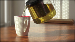 Pouring Tea In A Mug stock footage