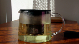 Pouring Hot Water Into Glass Teapot With Mint, Real Time stock footage