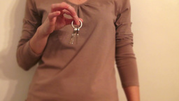 Woman Showing The House Keys, real time Footage