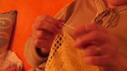 Woman's Hands Crocheting stock footage