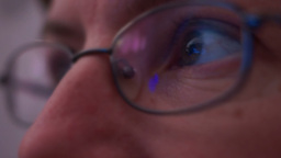 Computer Screen Reflected In Woman's Glasses stock footage