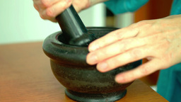 Grinding Cinnamon With Pestle And Mortar Footage