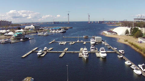 Flying Above Yachts at a Marina Footage