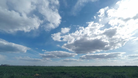 Clouds Sweep Over the Green Field Footage
