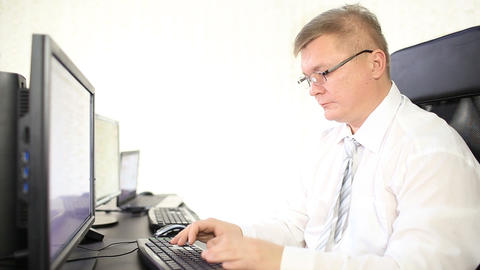 Woman With Headphones Working On A Computer stock footage