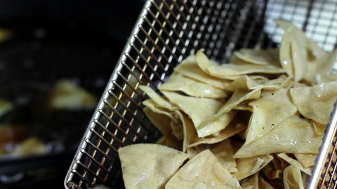 Mexico, 2014: CLOSE UP-HANDHELD SHOT. Tortilla Chips Being Cooked stock footage
