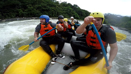 Group of seven people paddling hard on Pastaza river Ecuador Footage