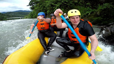 Oversized adult men heavy exercise on white water rafting Footage