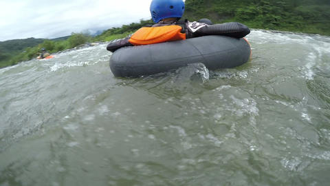 Extreme white water tubing close up sequence Footage