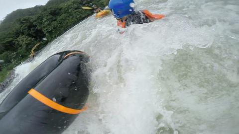 White water tubing adventurer recued by security kayaker Footage
