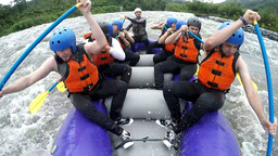 Nine people group whitewater rafting on rainy day Footage