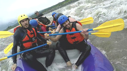 Whitewater rafting boat gets hit by huge water wave HD Footage