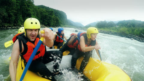 Adult Caucasian family having fun on white water rafting trip nine people group ビデオ