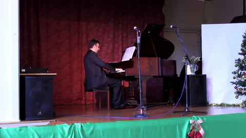 Male Playing The Piano On The Stage - Christmas Decoration stock footage