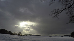 Time Lapse; Thick Clouds Passing, Landscape In Snow stock footage