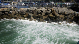 Water crashing against breakwater Footage