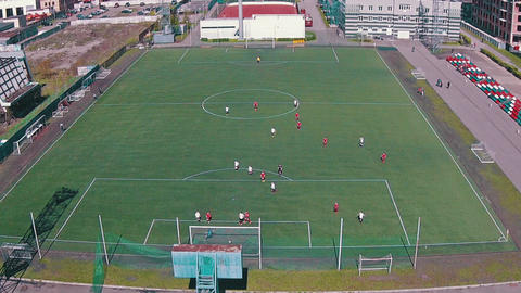 Aerial View Of School Team Playing Football stock footage