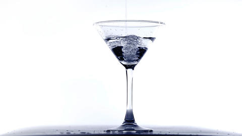 Pouring Martini Into Glass stock footage