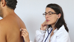 Femal doctor with stethoscope examine patient Footage