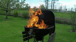 Fire In Metal Grill stock footage
