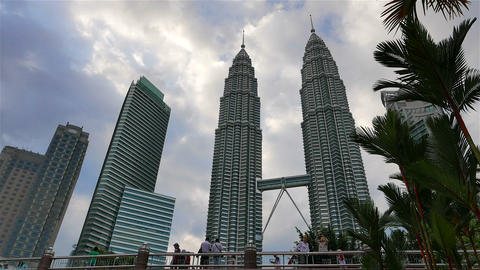KUALA LUMPUR - February 2015: Petronas Twin Towers with tourists taking pictures Footage