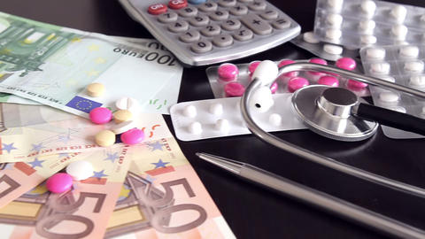 Health costs concept - pills and euro money Footage