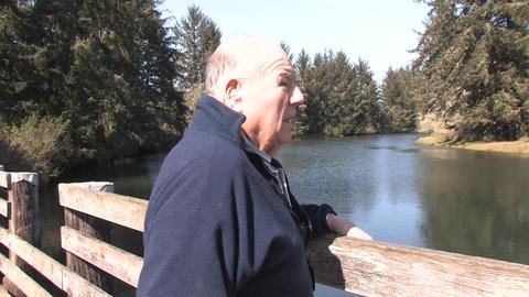 Senior Walking Along River Stock Video Footage