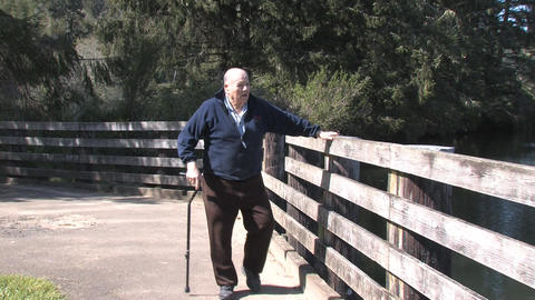 Senior Walking Along River Stock Video Footage