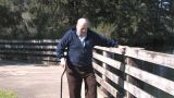 Senior Walking Along River Footage