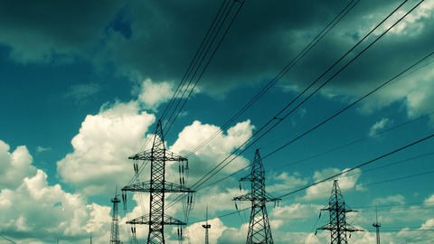 electric high voltage pylon against sky, time lapse Stock Video Footage