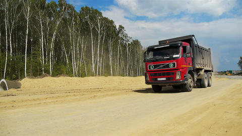 Red truck goes by Stock Video Footage