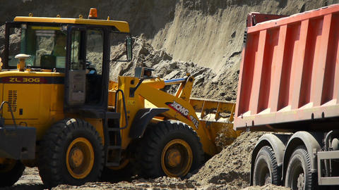 Yellow loader working on a construction site Stock Video Footage