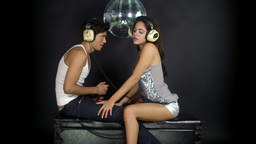 young couple dancing with retro headphones Footage