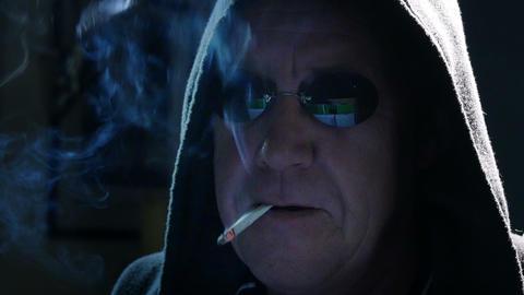 smoking internet hacker mimic close 4k UHD 11628 Footage