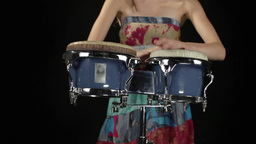 female percussion drummer performing with bongos Footage