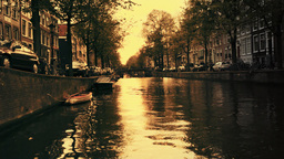 amsterdam canal city urban boats waterway europe sunset Footage
