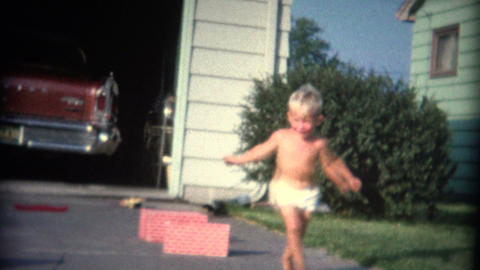 (8mm Vintage) Boy and Girl Jumping Over Walls Footage