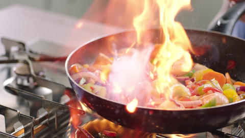 Frying vegetables and chicken white meat Footage