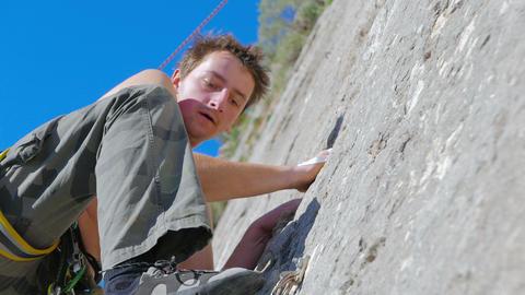 Caucasian person rock climbing Live Action