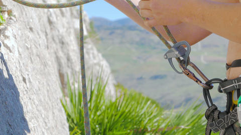Caucasian person rock climbing Footage